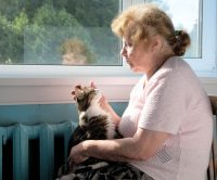 older woman with cat